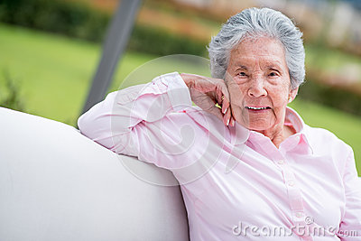 Retired woman relaxing outdoors