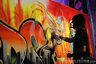 Drawing with Can Spay - Graffito - Man Painting Editorial Stock Image