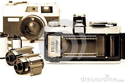Retro 35mm camera with film opened back side.