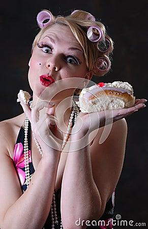 Retro 50s style female with cream cake