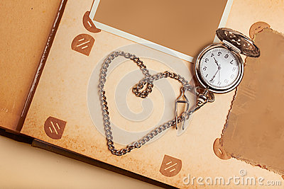 Retro album page with vintage clock with chain