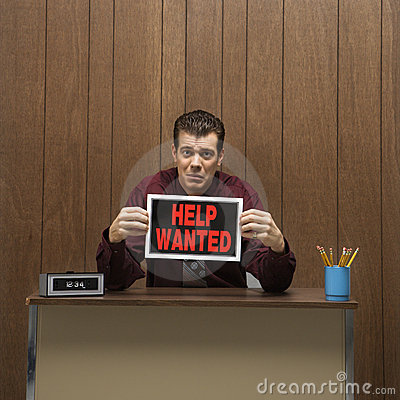 Retro businessman holding help wanted sign.