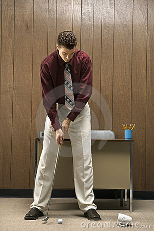 Free Retro Businessman Playing Golf In Office. Royalty Free Stock Image - 2047036