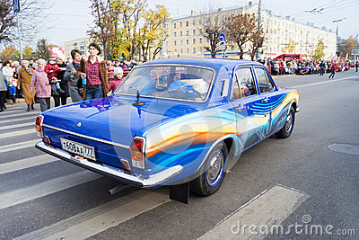 Retro car Volga GAZ 24 on the Olympic torch relay Editorial Stock Photo