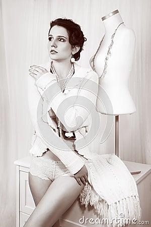 Retro fashion woman as tailor near dummy