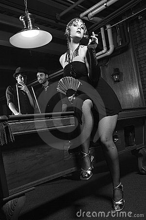 Retro female by pool table.