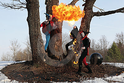 Retro fire-eater showing fire-show on forest