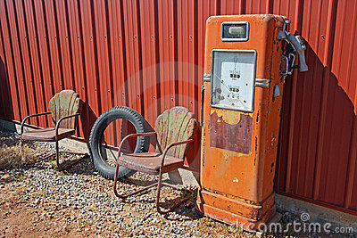 Retro gas pump and rusted chairs