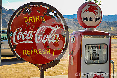 Retro gas pump and rusty coca-cola sign on route 66 Editorial Stock Photo