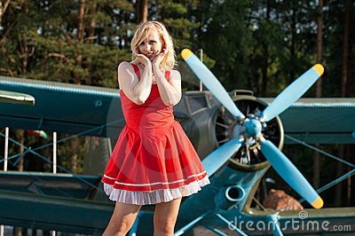 retro girl on background of vintage plane