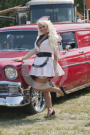 Retro girl with old car