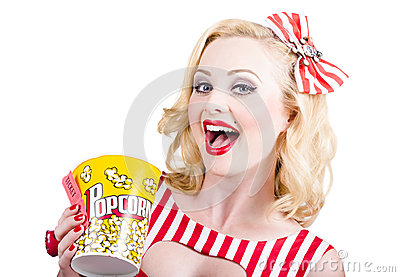 Retro girl taking popcorn to cinema