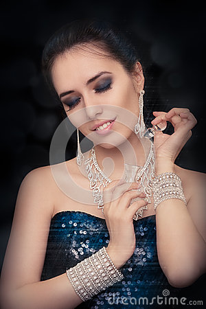 Free Retro Glamour Woman Holding Vintage Perfume Bottle Wearing Silver Accessories Stock Image - 44603531