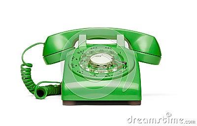 Retro green phone on white background.