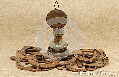 Retro kerosene lamp rusty horse shoes linen