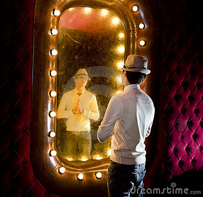 Retro man looks on mirror