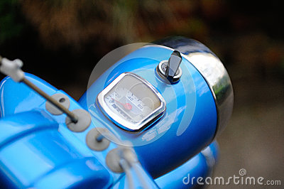 Retro moped cockpit with blurred background