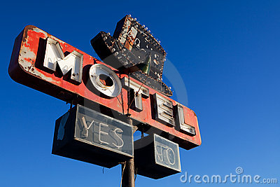 Retro motel sign blue sky