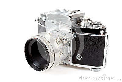 Retro old vintage analog photo camera on white