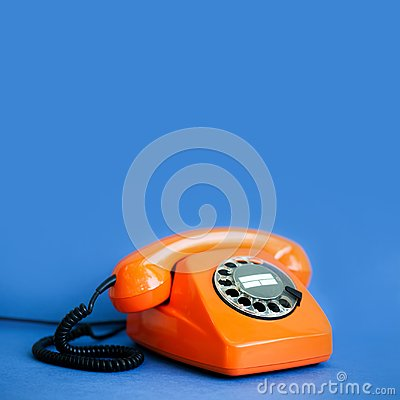 Free Retro Phone Orange Color, Vintage Handset Receiver On Blue Background. Shallow Depth Field Photography, Copy Space Royalty Free Stock Photo - 111040875