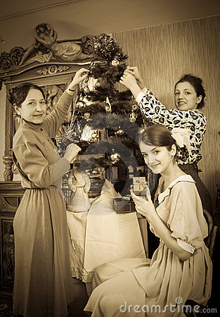Retro photo of family decorating Christmas tree