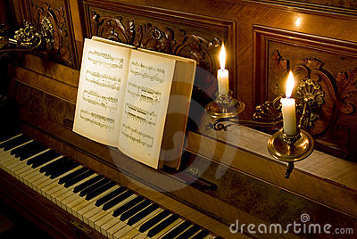 Retro piano with candle light
