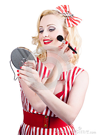 Retro pin-up woman doing beauty make-up