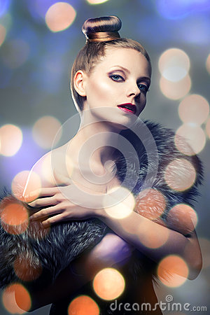 Retro portrait of beautiful woman in fur coat