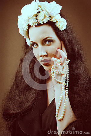 Retro portrait of a beautiful woman. Vintage style.