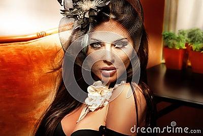 Retro portrait of fashionable brunette woman.