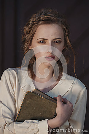 Free Retro Portrait Of A Beautiful Dreamy Girl Holding A Book In Hands Outdoors. Soft Vintage Toning. Royalty Free Stock Image - 97364656