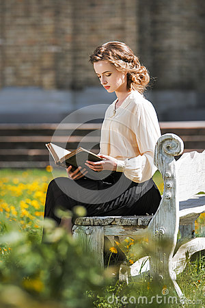 Free Retro Portrait Of A Beautiful Dreamy Girl Reading A Book Outdoors. Soft Vintage Toning. Royalty Free Stock Images - 97364459