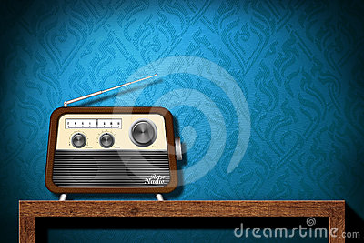 Retro radio on wood table with blue wallpaper