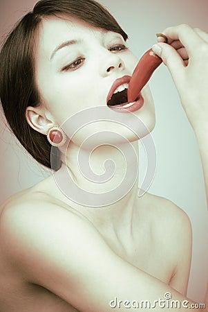 Free Retro Shot Of A Sexy Woman Biting A Chili Pepper Stock Image - 14780491