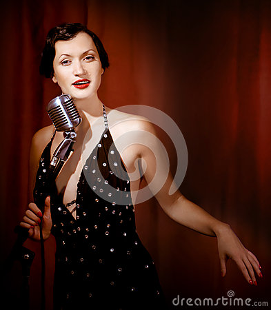 Retro singer sing holding vintage microphone