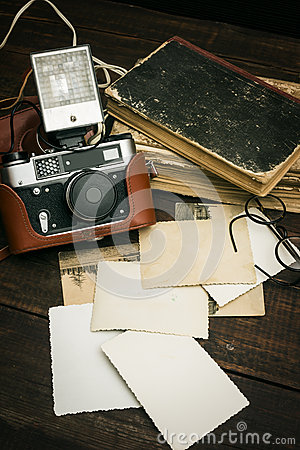 Free Retro Still Camera And Some Old Photos On Wooden Table Background Stock Photography - 57165522