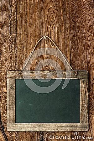 Retro style chalkboard on wooden wall