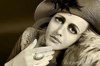 Retro style portrait of a young woman in hat