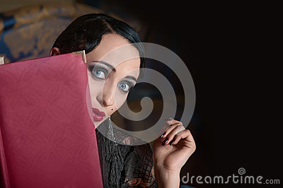 Retro style woman with menu book (looking out)
