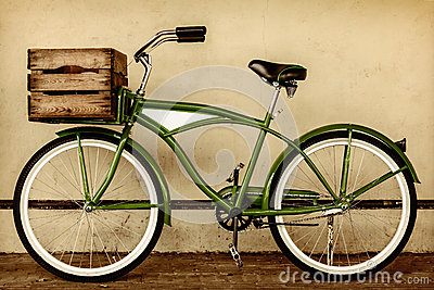 Retro styled sepia image of a vintage bicycle with wooden crate