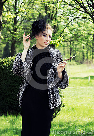 Retro-styled woman with cigarette