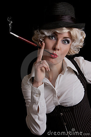 Retro-styled woman in hat with cigarette
