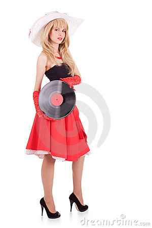 Retro stylish young woman with pramophone record