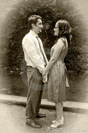 Retro vintage love - two lovers holding hands
