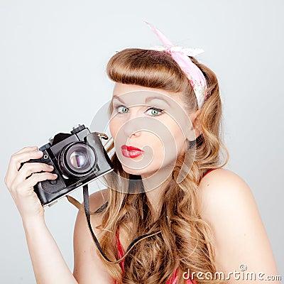 Retro woman with camera