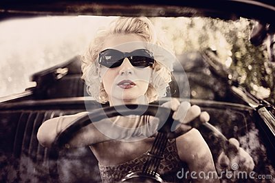 Retro woman driving a car