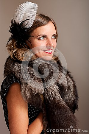 Retro woman with feather and fur
