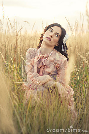 Retro woman in field