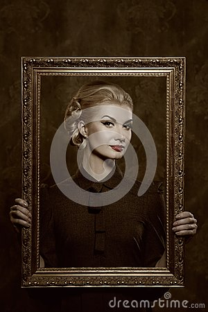 Retro woman holding a picture frame in her hands