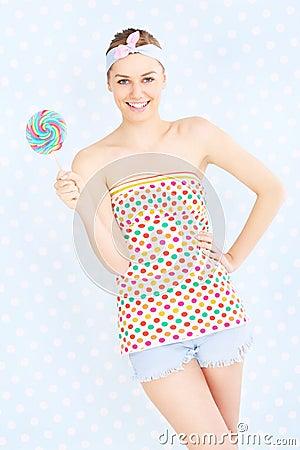 Retro woman with lollipop